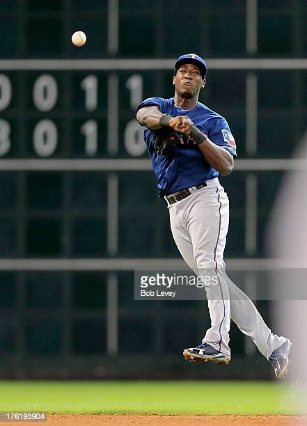 Jurickson Profar of the Texas Rangers throws to first base against the Houston Astros at Minute Maid Park on August 11 2013 in Houston Texas