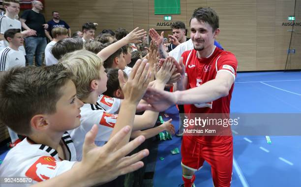 Jurii Melnyk of Hohenstein Ernstthal celebrates with his supporters after winning the German Futsal Championship final match between VfL...