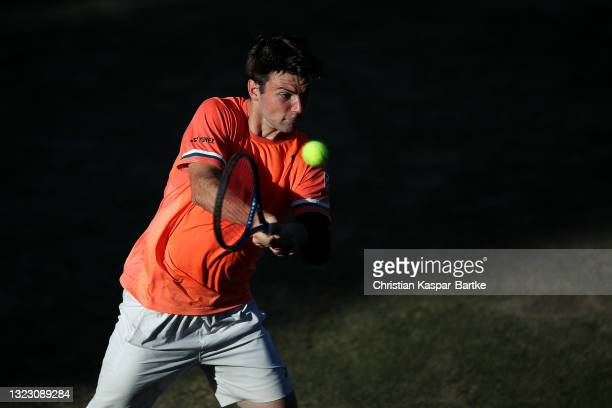 Jurij Rodionov of Austria plays a backhand during his match against Alex De Minaur of Australia during day 5 of the MercedesCup at Tennisclub...