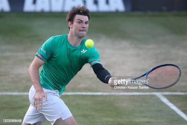 Jurij Rodionov of Austria plays a forehand during his match against Alex De Minaur of Australia during day 5 of the MercedesCup at Tennisclub...