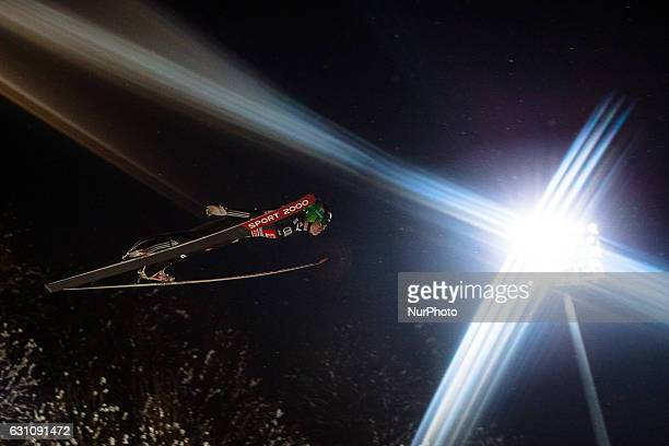 Jurij Tepes of Slovenia soars through the air during his first competition jump on Day 2 on January 6 2017 in Bischofshofen Austria