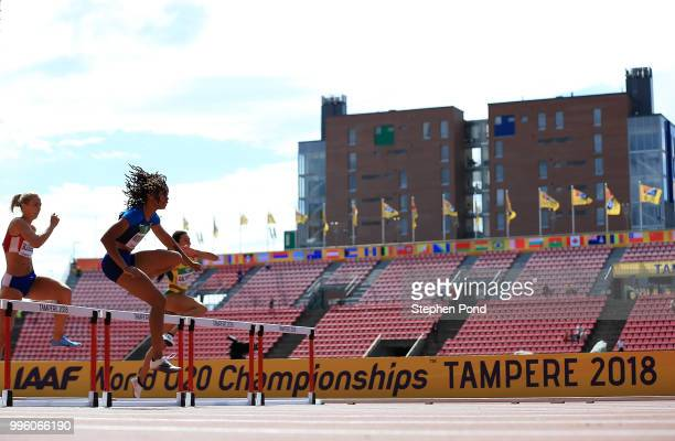 Jurnee Woodward of The USA jumps a hurdle during heat 6 of the women's 400m hurdles on day two of The IAAF World U20 Championships on July 10 2018 in...