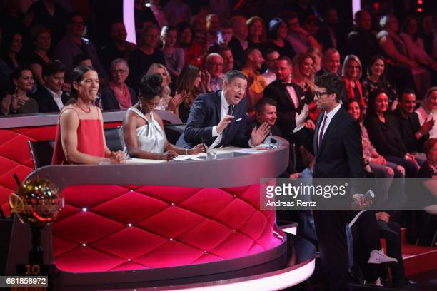 Juror Joachim Llambi discusses with Host Daniel Hartwich after the performance of Anni FriesingerPostma and Erich Klann during the 3rd show of the...