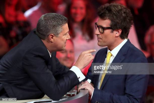 Juror Joachim Llambi talks to host Daniel Hartwich on stage during the 5th show of the 11th season of the television competition 'Let's Dance' on...