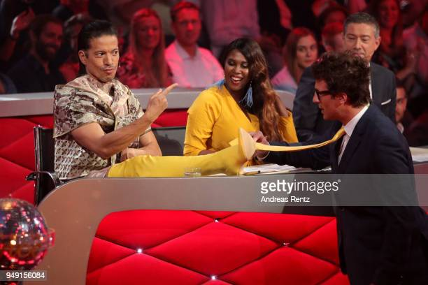 Juror Jorge Gonzalez shows his yellow boots to Motsi Mabuse Joachim Llambi and Host Daniel Hartwich on stage during the 5th show of the 11th season...