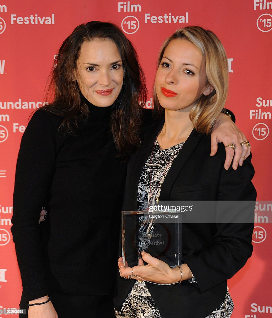 Juror Winona Ryder and director Crystal Moselle pose backstage at the Awards Night Ceremony during the 2015 Sundance Film Festival at the Basin Recreation Field House on January 31, 2015 in Park City, Utah.