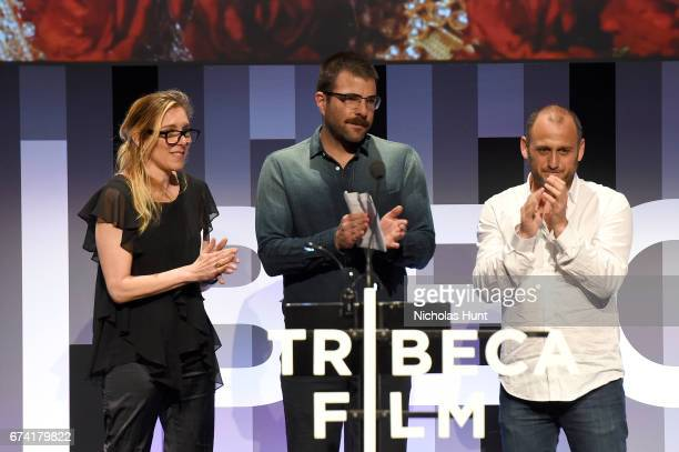 Jurors Amy Berg Zachary Quinto and Shaul Scwarz present the New Documentary Award onstage during Awards Night during the 2017 Tribeca Film Festival...
