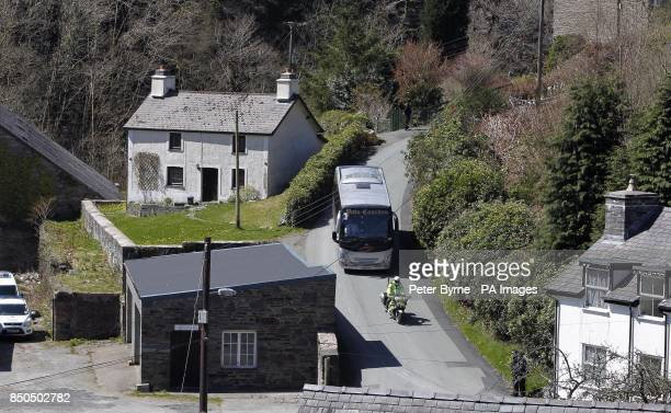 Jurors arrive outside the home of Mark Bridger in Ceinws Mid Wales during his trial for the abduction and murder of April Jones