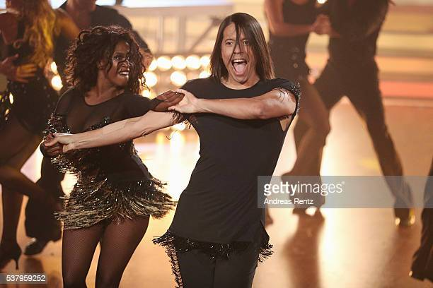 Jurors Jorge Gonzalez and Motsi Mabuse perform on stage during the final show of the television competition 'Let's Dance' on June 3, 2016 in Cologne,...