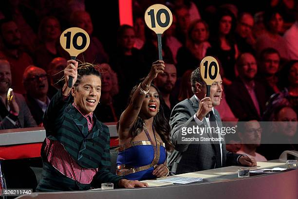 Jurors Jorge Gonzalez, Motsi Mabuse and Joachim Llambi show the 10-points-sign during the 7th show of the television competition 'Let's Dance' at...