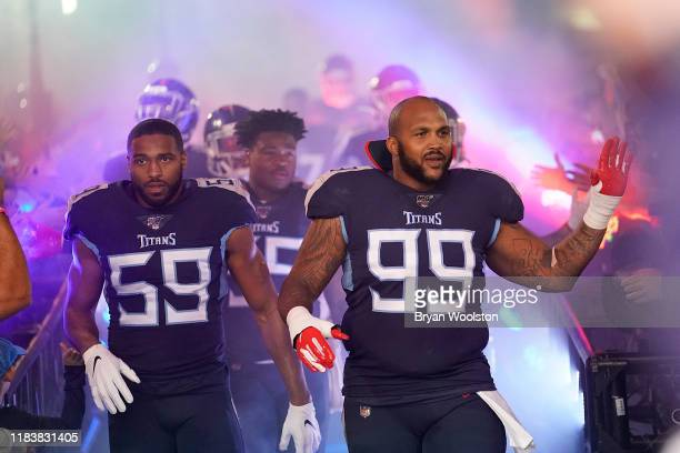 Jurrell Casey and Wesley Woodyard of the Tennessee Titans lead teammates past awaiting fans before the NFL football game against the Tampa Bay...