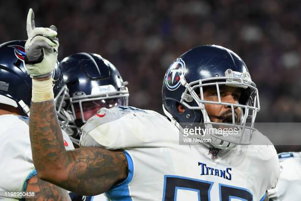 Jurrell Casey of the Tennessee Titans celebrates after a fumble by the Baltimore Ravens during the AFC Divisional Playoff game at M&T Bank Stadium on...
