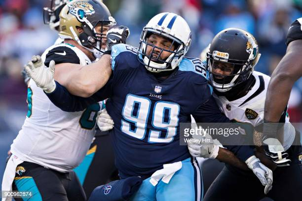 Jurrell Casey of the Tennessee Titans is blocked by Brandon Linder of the Jacksonville Jaguars at Nissan Stadium on December 31, 2017 in Nashville,...