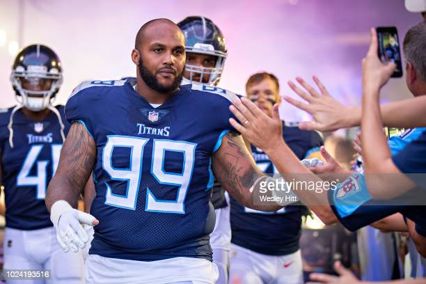 Jurrell Casey of the Tennessee Titans jogs greets fans as he walks onto the field before a game against the Tampa Bay Buccaneers at Nissan Stadium...