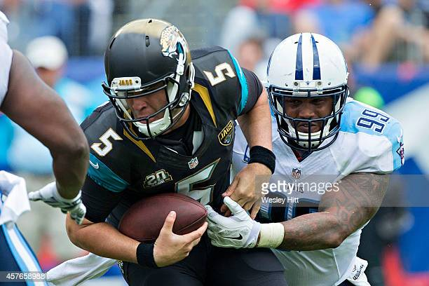Jurrell Casey of the Tennessee Titans sacks Blake Bortles of the Jacksonville Jaguars at LP Field on October 12 2014 in Nashville Tennessee The...