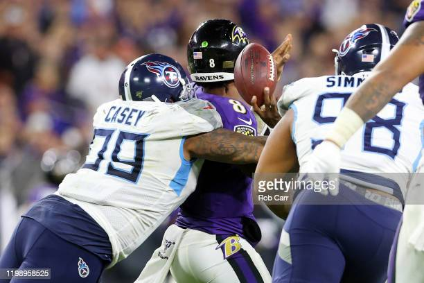 Jurrell Casey of the Tennessee Titans sacks Lamar Jackson of the Baltimore Ravens during the second half in the AFC Divisional Playoff game at M&T...
