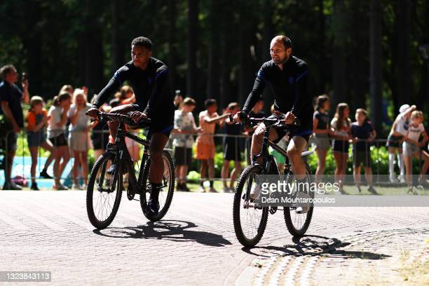 Jurrien Timber and Daley Blind of Netherlands arrive on bikes prior to the Netherlands Training Session ahead of the UEFA Euro 2020 Group C match...