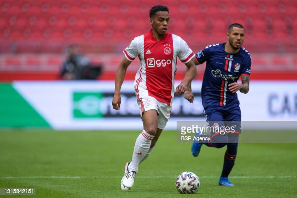 Jurrien Timber of Ajax and Sergio Pena of FC Emmen during the Dutch Eredivisie match between Ajax and FC Emmen at Johan Cruijff Arena on May 2, 2021...