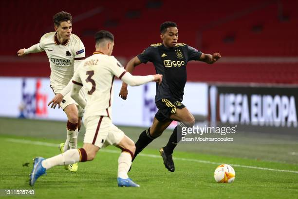 Jurrien Timber of Ajax runs with the ball whilst under pressure from Riccardo Calafiori of A.S Roma during the UEFA Europa League Quarter Final First...