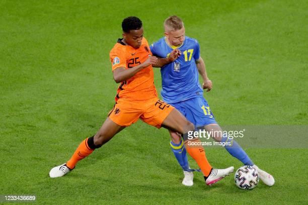 Jurrien Timber of Holland, Oleksandr Zinchenko of Ukraine during the EURO match between Holland v Ukraine at the Johan Cruijff Arena on June 13, 2021...