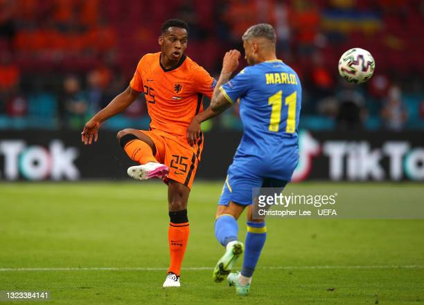 Jurrien Timber of Netherlands passes the ball whilst under pressure from Marlos Marlos of Ukraine during the UEFA Euro 2020 Championship Group C...