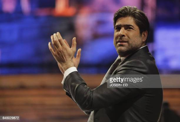 Jury member Arab singing star Wael Kfoury applauds a candidate in the Arab Idol TV show during the last show before the final in the panArab song...