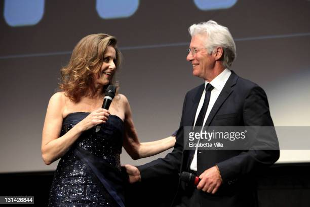 Jury member Debra Winger and actor Richard Gere as he accepts his Marc' Aurelio award for Lifetime Achievement during the Closing Ceremony of the 6th...