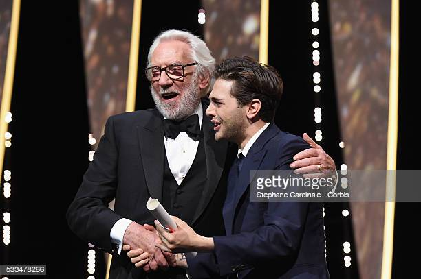 Jury member Donald Sutherland presents to director Xavier Dolan The Grand Prix for the movie 'Just the end of the world' during the Closing Ceremony...