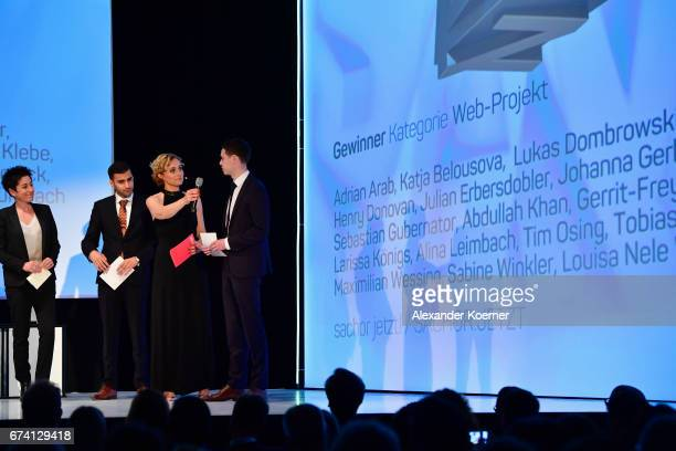 Jury member Dunja Hayali hands over the 'WebProject' Award to Team members of the 'Sachor jetzt' Project at the Nannen Award 2017 on April 27 2017 in...