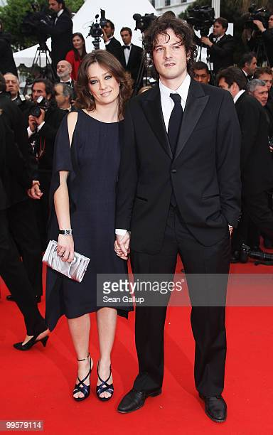 Jury member Giovanna Mezzogiorno and husband Alessio Fugolo attend the You Will Meet A Tall Dark Stranger Premiere at the Palais des Festivals during...