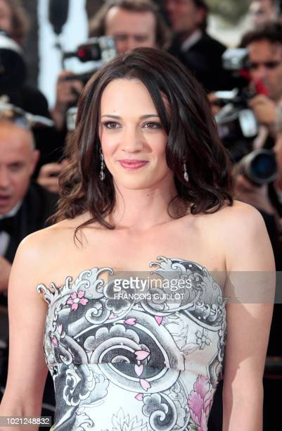 Jury member Italian actress and director Asia Argento poses upon her arrival for the opening ceremony and the screening of 3D animated movie 'Up'...