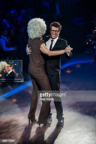 Jury member Jorge Gonzalez and host Daniel Hartwich dance during the Final of 'Let's Dance Let's Christmas' TV Show on December 21 2013 in Cologne...