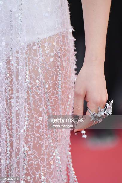 Jury member Lea Seydoux jewelry detail attends the screening of Everybody Knows and the opening gala during the 71st annual Cannes Film Festival at...