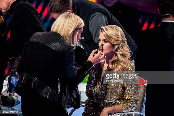 Jury member Lena Gercke gets some makeup during the second Semifinal of 'Das Supertalent' TV Show on December 07 2013 in Cologne Germany