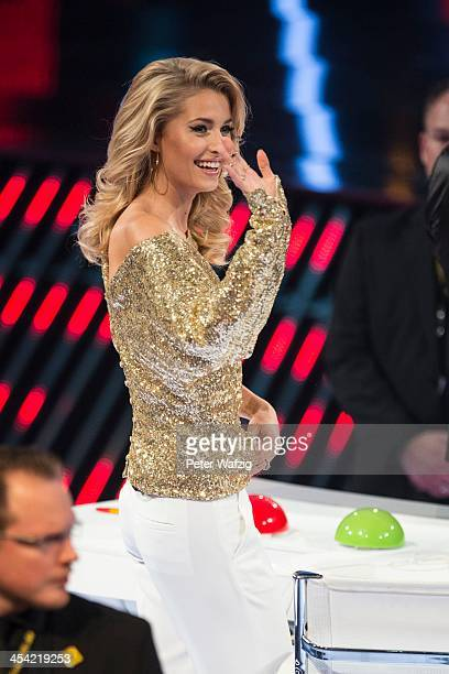 Jury member Lena Gercke waves at the audience during the second Semifinal of 'Das Supertalent' TV Show on December 07 2013 in Cologne Germany