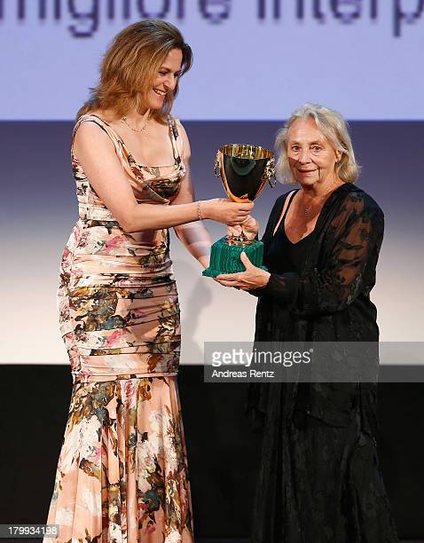 Jury Member Martina Gedeck presents on stage the Best Actress Award to actress Elena Cotta which she received for her role in the movie 'Via...