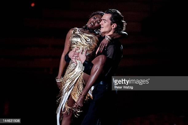 Jury member Motsi Mabuse performs together with Evgenij Voznyuk during 'Let's Dance' Semi Finals at Coloneum on May 16 2012 in Cologne Germany