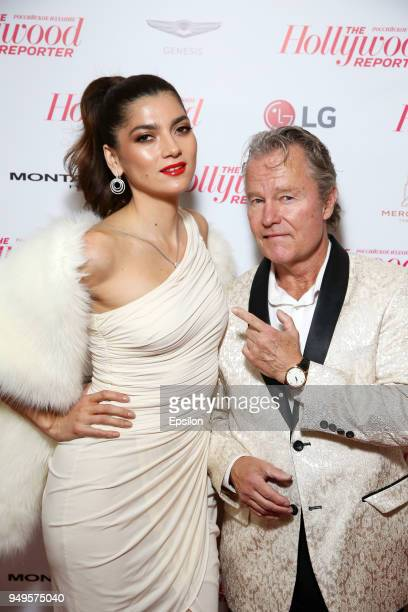 Jury member of the main competition actor John Savage and actress Blanca Blanco attend a White party by the Hollywood Reporter Russian edition at...
