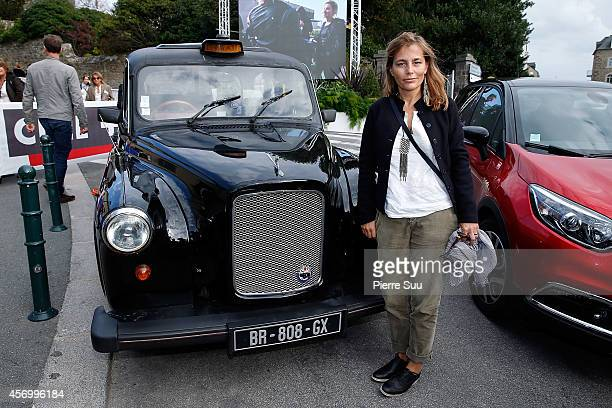 Jury Member Sophie Duez poses in front of a black cab at 'Palais des arts' on October 10, 2014 in Dinard, France.