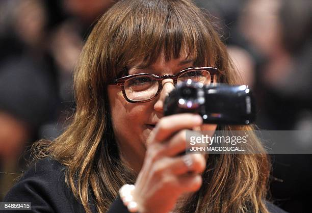 Jury member Spanish director Isabel Coixet films with a digicam on the red carpet ahead of the premiere of the film The International by German...