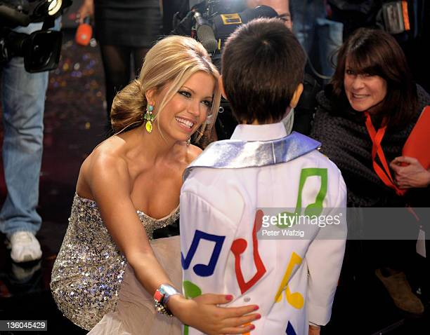 Jury member Sylvie van der Vaart together with finalist Ricky Kam during the Final of 'Das Supertalent' TV Show on December 17 2011 in Cologne Germany