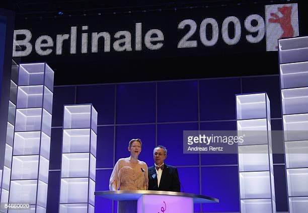 Jury member Tilda Swinton and Berlin FIlm Festival director Dieter Kosslik talk at the opening ceremony as part of the 59th Berlin Film Festival at...