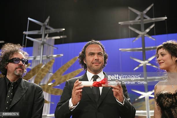 Jury member Tim Burton and actress Marion Cotillard present Mexican director Alejandro Gonzalez Inarritu with the 'Best Director' award for 'Babel'...