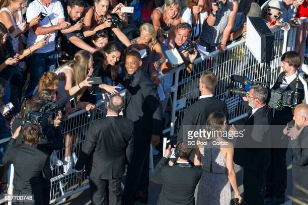 Jury member Will Smith greets fans as he attends the 70th Anniversary of the 70th annual Cannes Film Festival at Palais des Festivals on May 23 2017...