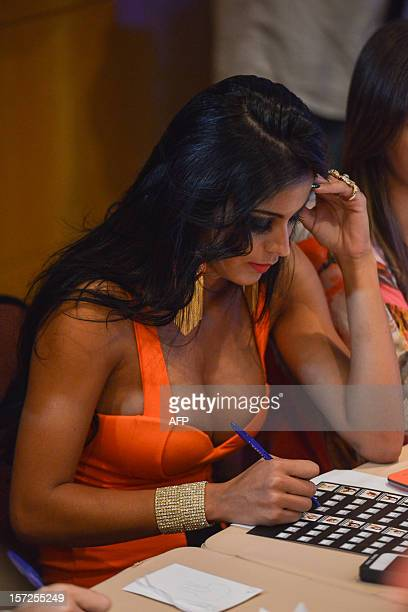 A jury member writes down results during the Miss Bumbum pageant in Sao Paulo on November 30 2012 All eyes are on Brazil's annual Miss Bumbum pageant...