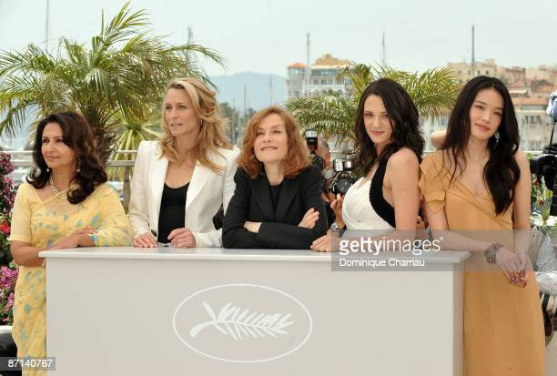 Jury members actresses Sharmila Tagore Robin Wright Penn jury president Isabelle Huppert Asia Argento and Shu Qi attend the Jury Photocall at the...