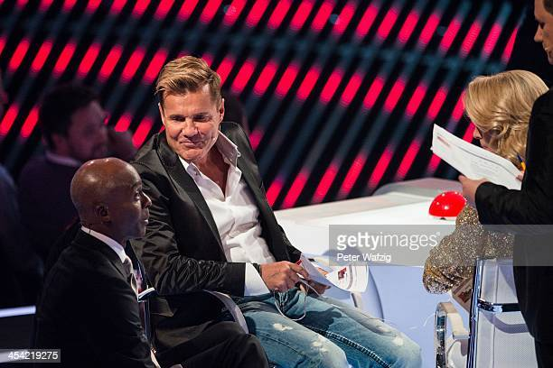Jury members Bruce Darnell Dieter Bohlen and Lena Gercke talk during the second Semifinal of 'Das Supertalent' TV Show on December 07 2013 in Cologne...