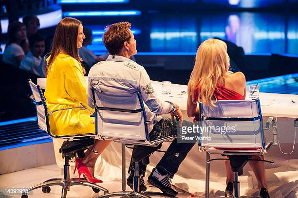 Jury members Dana Schweiger Dieter Bohlen and Michelle Hunziker listen to a performance during DSDS Kids 1st Show at Coloneum on May 05 2012 in...