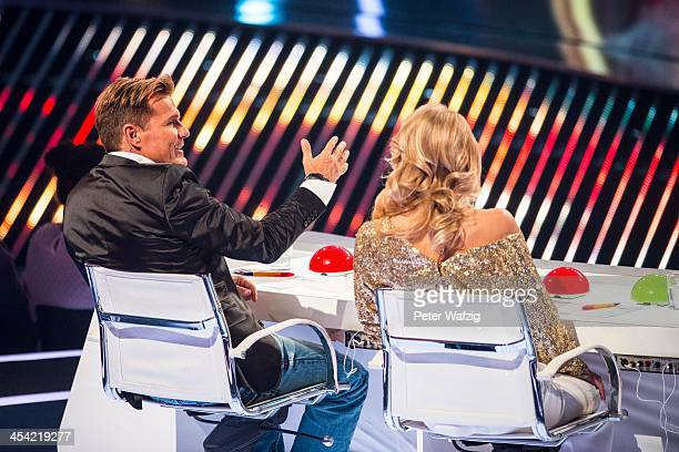 Jury members Dieter Bohlen and Lena Gercke talk during the second Semifinal of 'Das Supertalent' TV Show on December 07 2013 in Cologne Germany