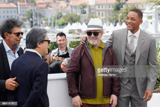 Jury members Gabriel Yared Park Chanwook President of the jury Pedro Almodovar and jury member Will Smith attend the Jury photocall during the 70th...